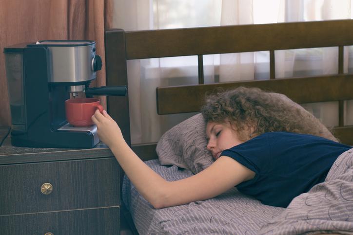 Girl asleep by coffee pot