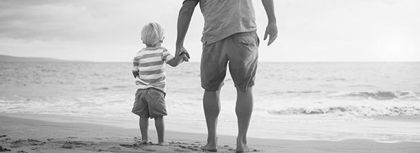 father and young son on beach