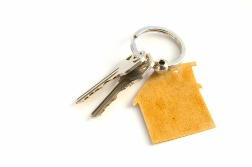 2 keys on a house shaped key chain