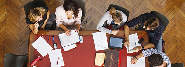 overhead view of students studying around a library table