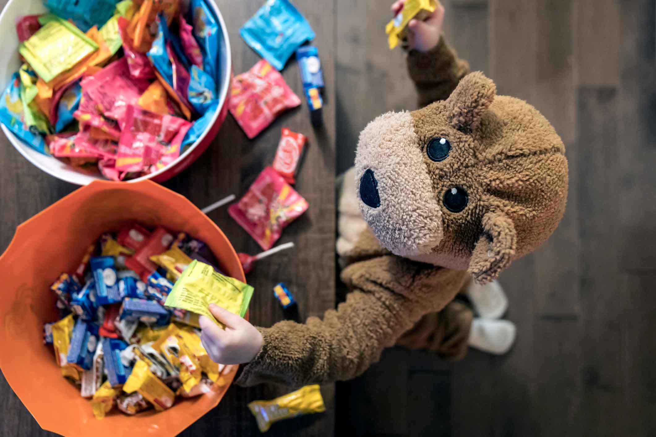 Kid Reaching for Halloween Candy