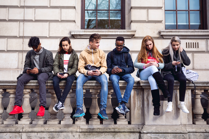 Group of teens on their smartphones