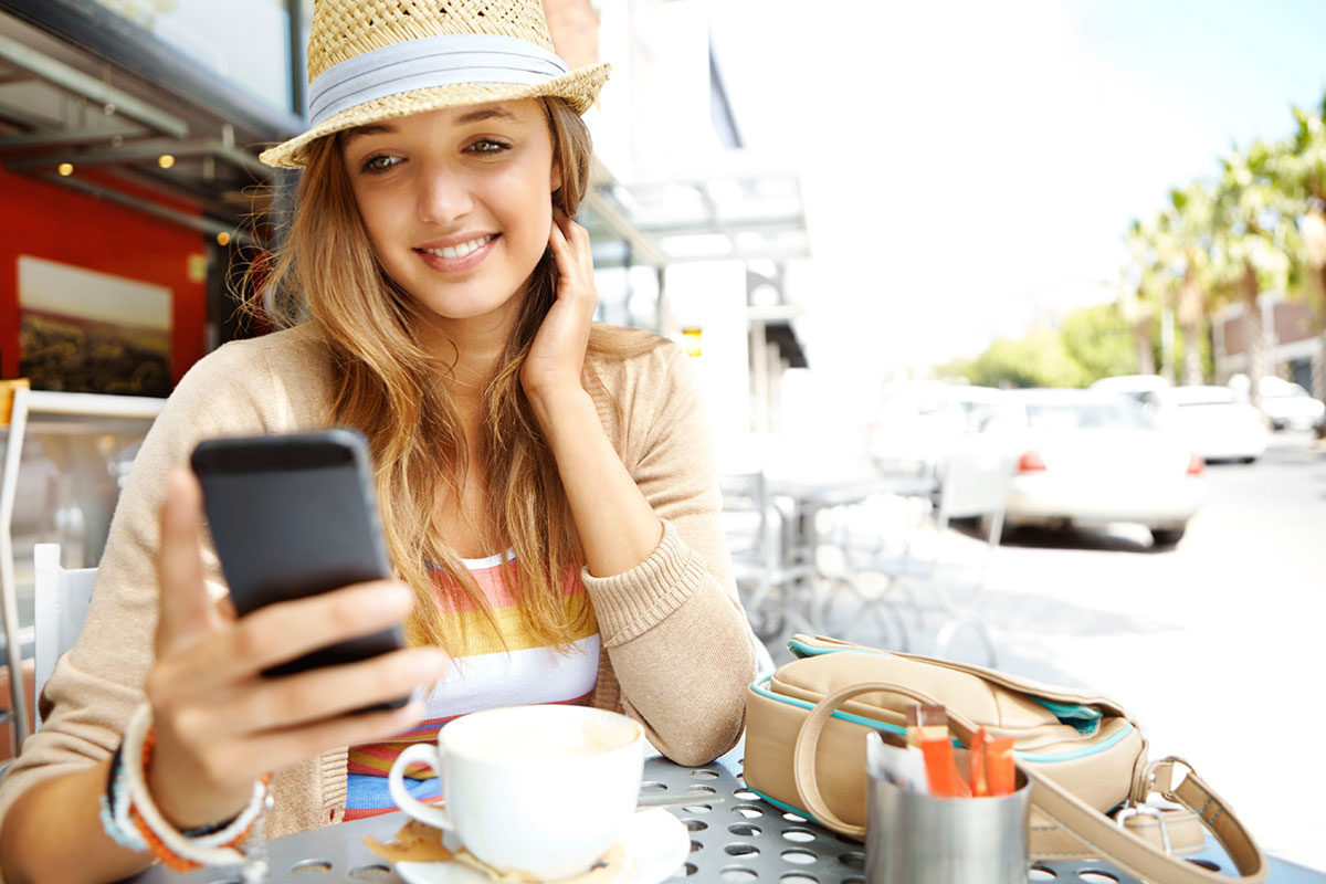 girl outside looking at cell phone
